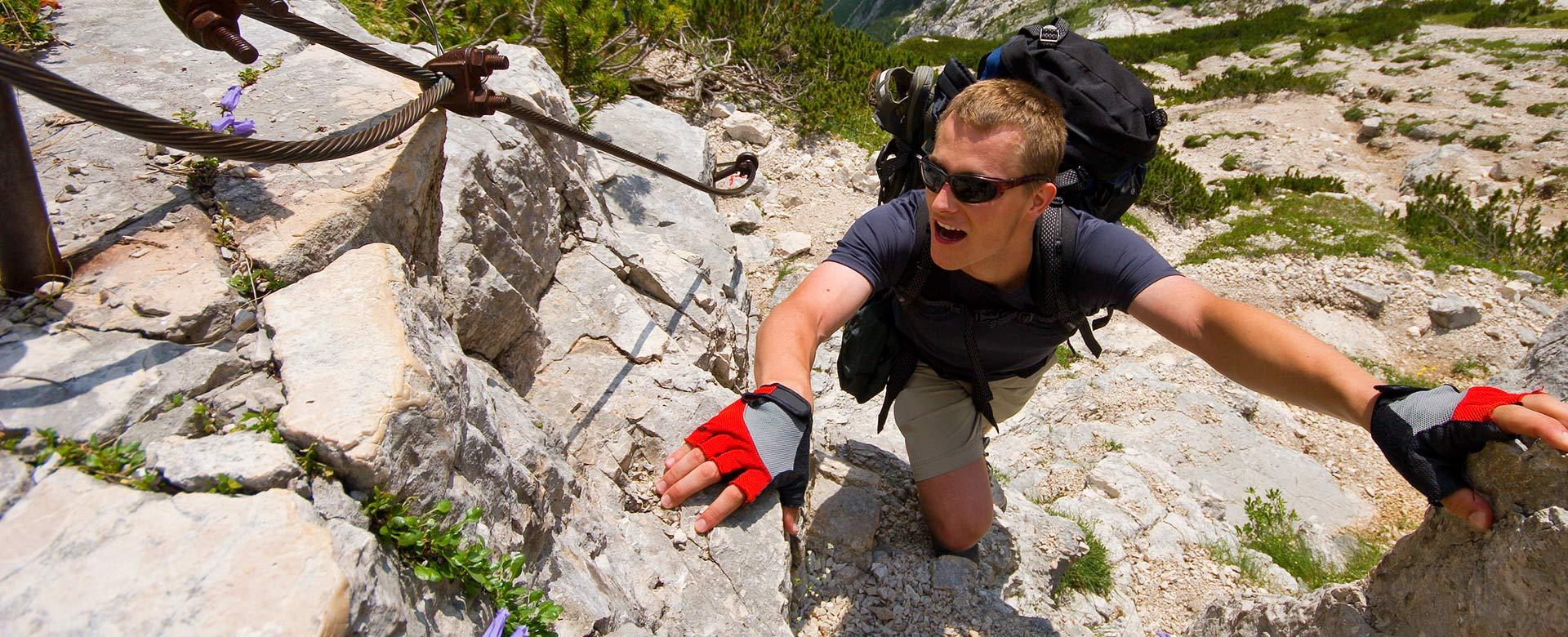 Man climbs up rocky path